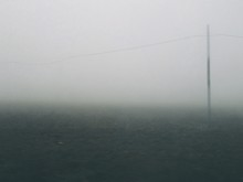 Pole On Landscape Against Sky During Foggy Weather