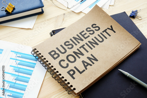 Fotomural BCP Business continuity plan is on the table.