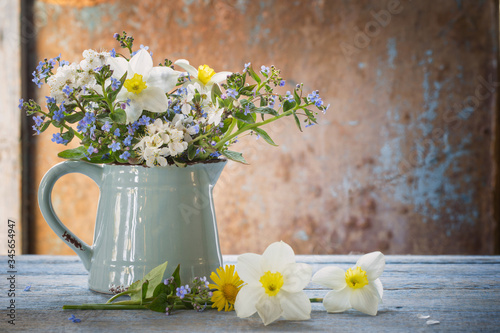 Fototapety, obrazy: spring flowers in jug on old wooden painted background