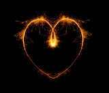heart, written with a sparkler on a black background