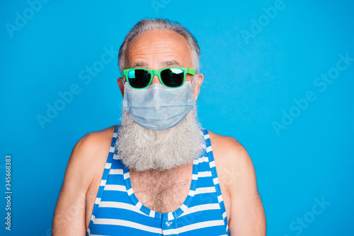 Tablou Canvas Closeup portrait of attractive funky glad gray haired old man spend leisure pool