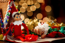 Close-up Of Figurine And Decorations On Table During Christmas