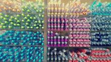Full Frame Shot Of Multi Colored Pens In Rack