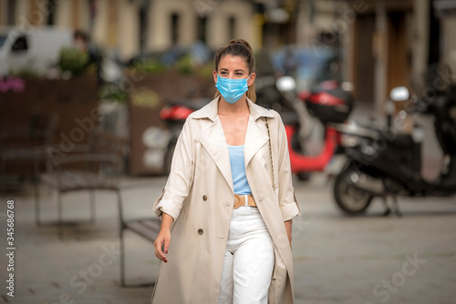 girl with medical mask walks down the street Wallpaper Mural