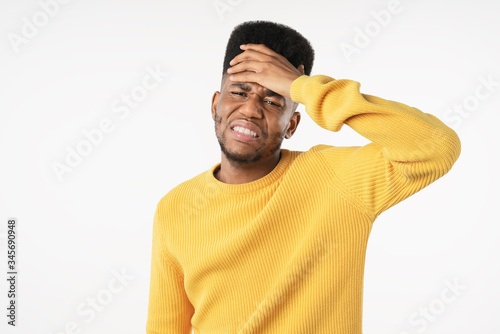 Young man with disgusted expression repulsing something over white background Fototapeta