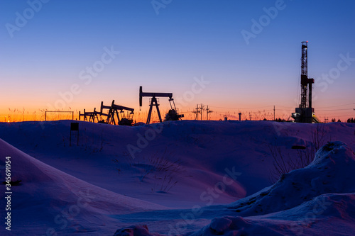 Oil and Gas Drilling Rig. Oil drilling rig operation on the platform in oil and gas industry. Global coronavirus COVID 19 crisis. Petroleum concept. War on oil prices. Environmental pollution.