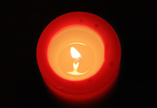 Red Candle With Black Backgrou...
