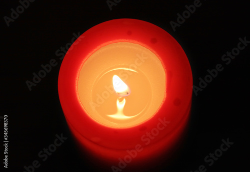 red candle with black background (view from top) Wallpaper Mural