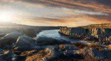 Scenic Image Nature Of Iceland. Amazing Tipical Icelandic Scenery During Sunset. The Most Beautiful Conyon With Black Basalt Columns  And River Under Sunligt In Iceland. Amazing Nature Landscape.
