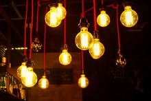 Low Angle View Of Illuminated Light Bulbs Hanging Indoors