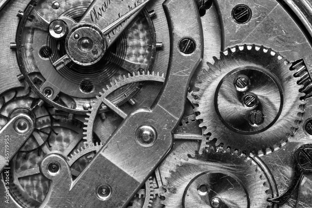Old Clock Watch Mechanism with gears - close-up, black and white
