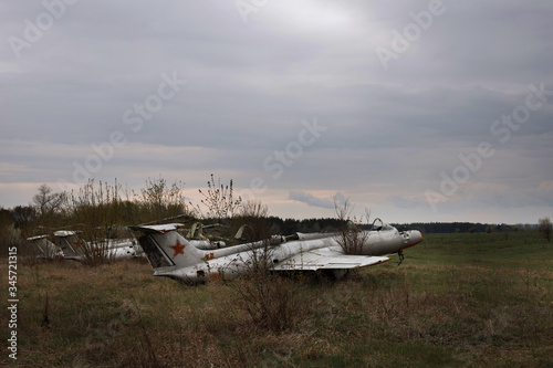 abandoned fighters in the field. abandoned airfield Wallpaper Mural
