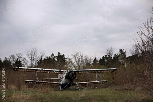 Destroyed vintage airplane in the field. abandoned airfield Canvas Print