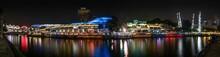 Illuminated Clarke Quay And River At Night