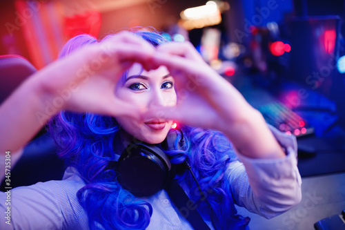 Fotografija Cosplay young beautiful woman with blue hair welcomes subscribers to stream for