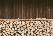 Stacked Firewood In Front Of A...