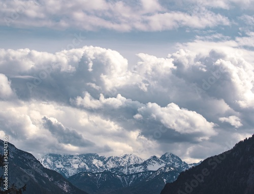 Huge cloud wall over the mountain tops of the Alps in Germany