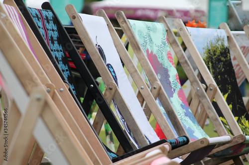 Wooden Deck Chairs In Garden Fotobehang