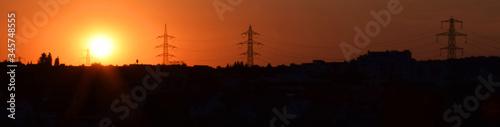 Obraz na plátně Silhouette Of Electricity Pylon At Sunset