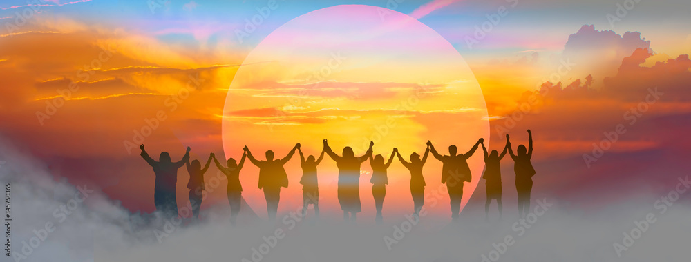 Fototapeta Business people holding and raised arms together on teamwork with sunrise background.