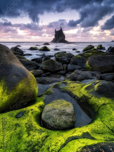 Rocks On Beach Against Sky During Sunset - fototapety na wymiar