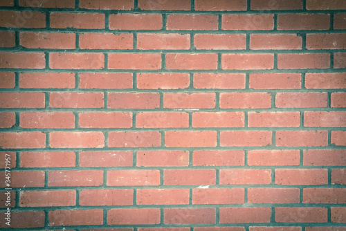 Filtered image rustic exposed red brick wall texture as background and design element