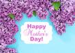 Leinwandbild Motiv Lilac flowers blue background Happy Mothers Day