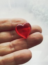 Woman Holding Red Heart In Hand