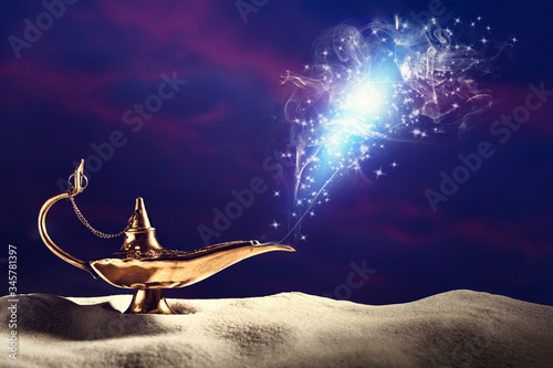 Photo Genie appearing from magic lamp of wishes. Fairy tale