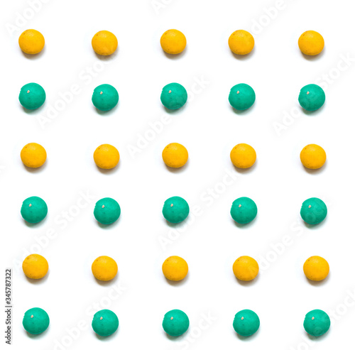 small yellow and green candy with white background Canvas Print