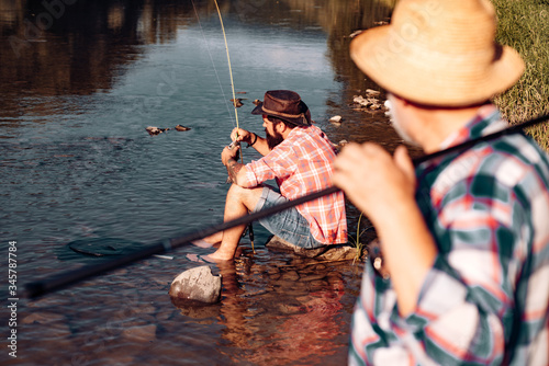 Photo Leisure and people concept male friends fishing