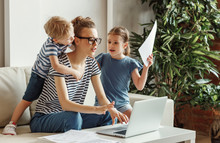 Stressed Woman With Kids Worki...