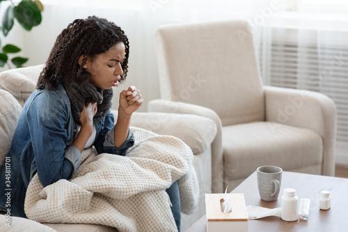 Respiratory illness. Sick black woman coughing hard at home Canvas-taulu