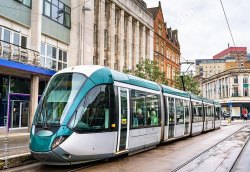 Платно City tram at Old Market Square in Nottingham, England