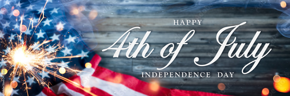 Fototapeta American Flag With Sparkler And Smoke On Wooden Background With Words