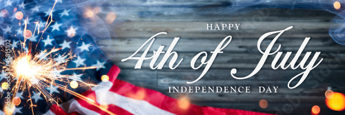 American Flag With Sparkler And Smoke On Wooden Background With Words Happy 4th Fototapeta