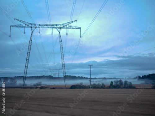 Obraz na plátně Low Angle View Of Electricity Pylon On Field Against Sky