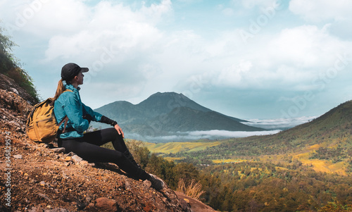 Woman admiring the  mountain valley in the way to ijen volcano Canvas Print