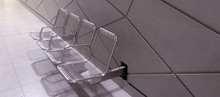 Metallic Chairs On Sidewalk
