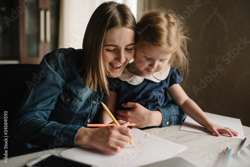 Fotografie, Obraz Mother working from home with a kid