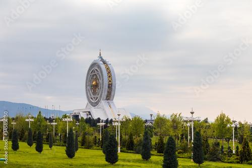 25 April 2020; Ashgabat, Turkmenistan; Covered ferris wheel Alem in the overcast Wallpaper Mural