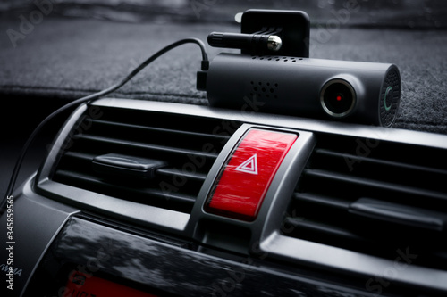 Car video camera (dash cam) and emergency light button in car ,Concept of safety Canvas