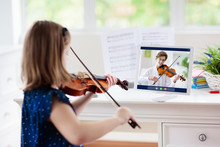 Child Playing Violin. Remote L...