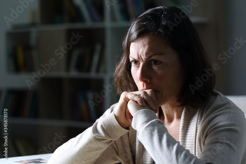 Angry middle age woman thinking at night at home Fototapeta