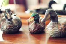 Close-up Of Duck Figurines On Table