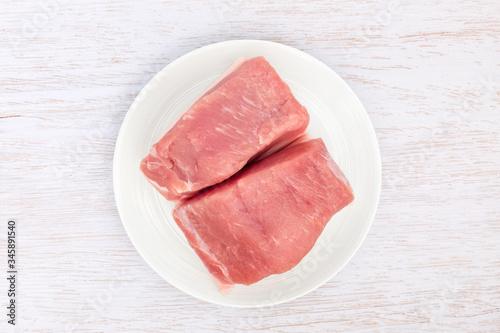 Photo Pork hind leg on white background