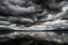 Dark Clouds On The Sky Over Lake