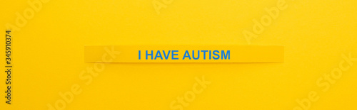 panoramic shot of bracelet with I have autism inscription isolated on yellow Canvas Print