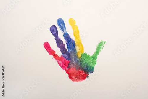 Valokuvatapetti top view of colorful handprint on white for World Autism Awareness Day