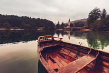 Wooden Dinghy Rowboat On Lake